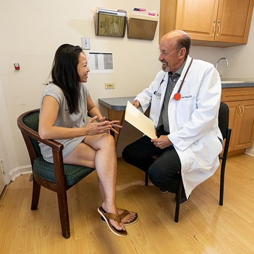patient talking with Dr. Fisher about fat and weight loss